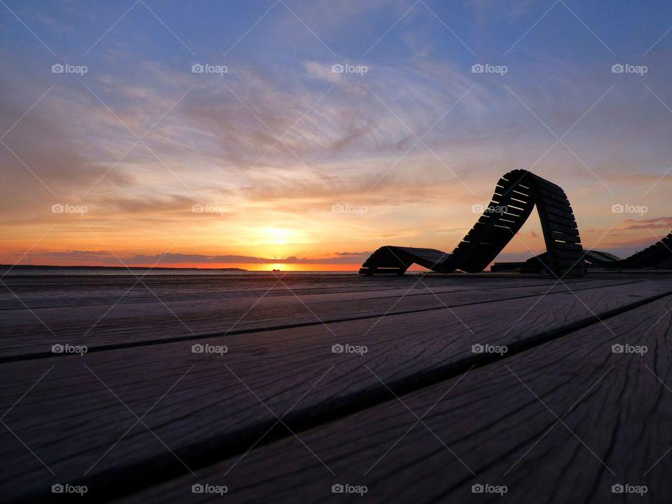 Empty chair near sea