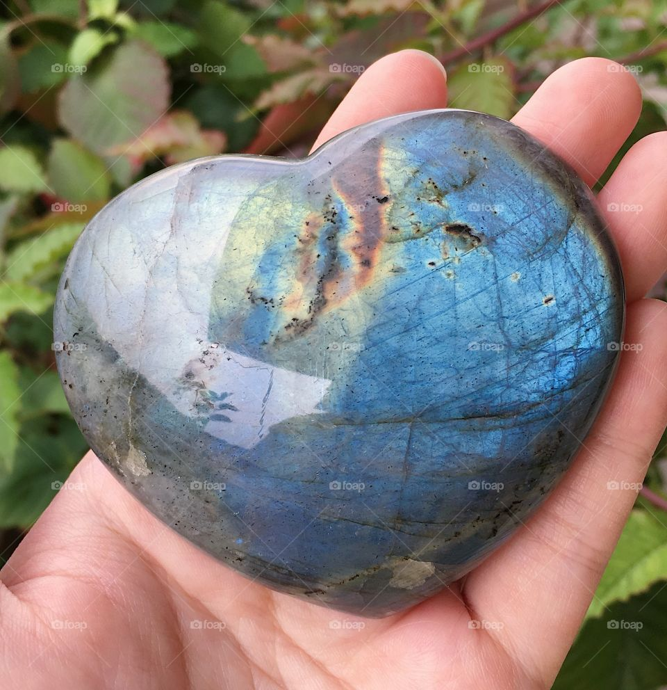 A heart-shaped labradorite mineral stone.