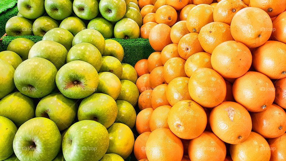 Heap of an apple and oranges