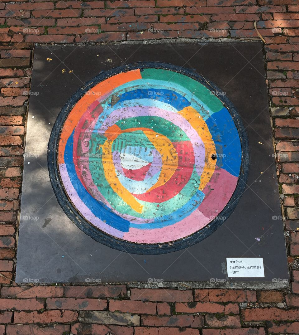Manhole Cover Painted in Rainbow Colours - Shenzhen, China