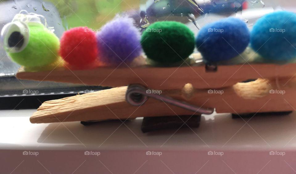 Caterpillar craft. Diy. Rainbow puff balls on wooden clothespin.