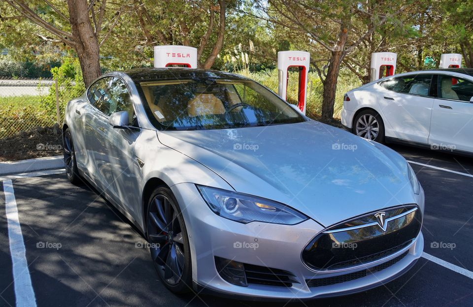 Tesla Model S Electric Car At Charging Station In Silicon Valley