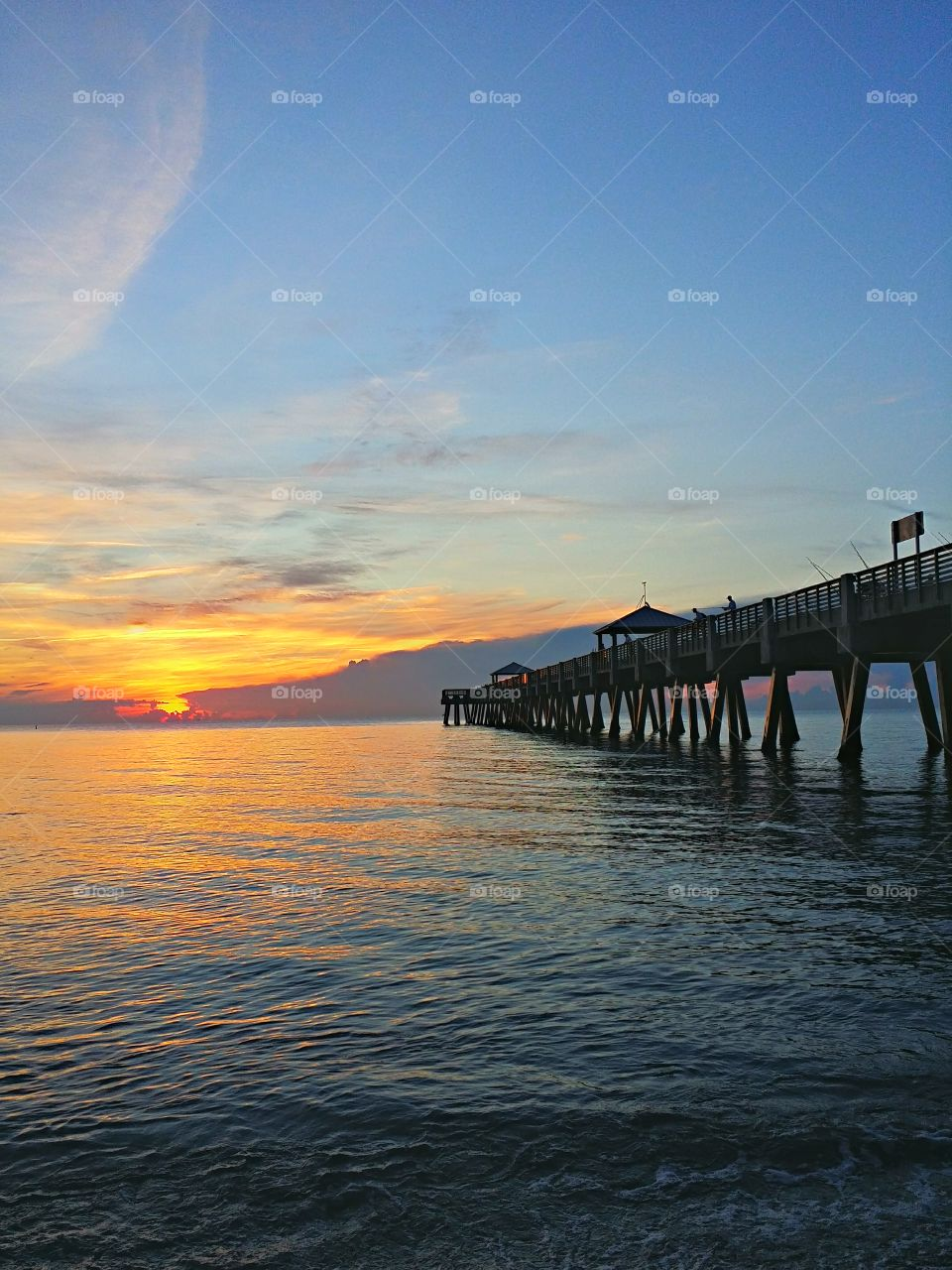 Sunrise at the Pier. Beautiful sunrise promises a great day!