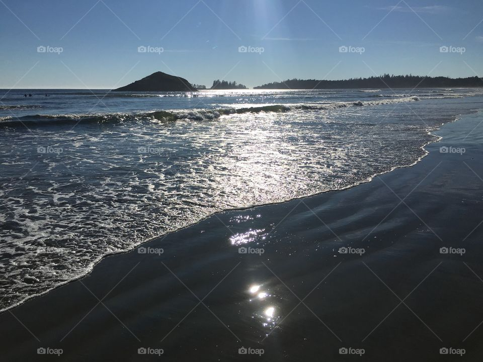 Scenic view of a beach against clear sky