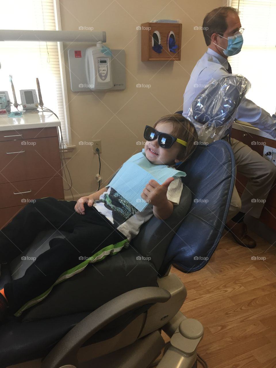 Small boy smiling in dental office