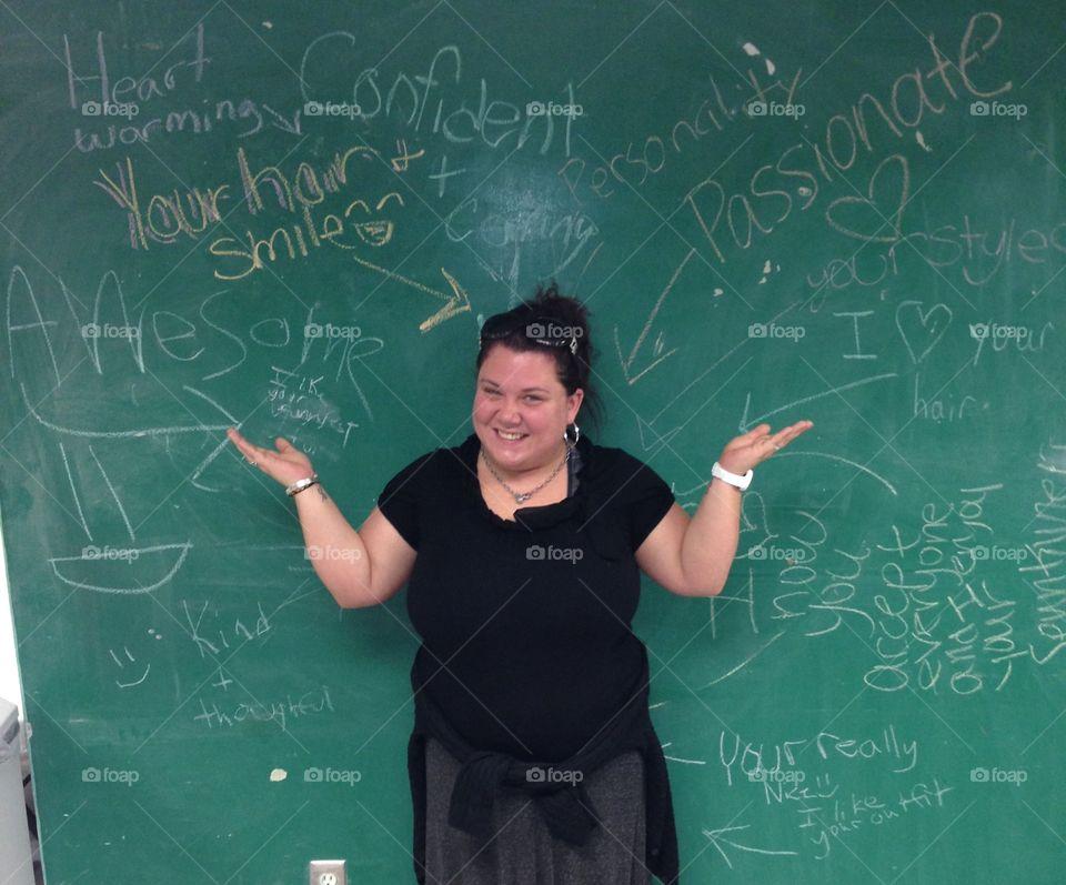 Female teacher in front of board