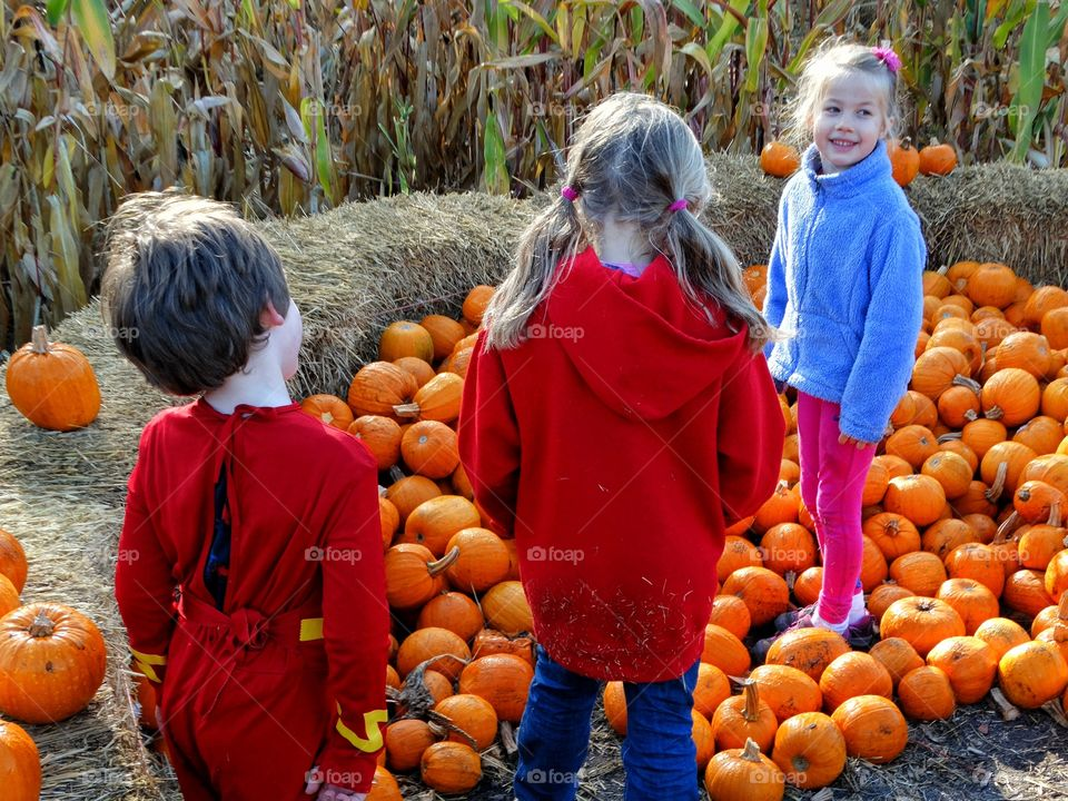 Young Children At The Pumpkin Patch
