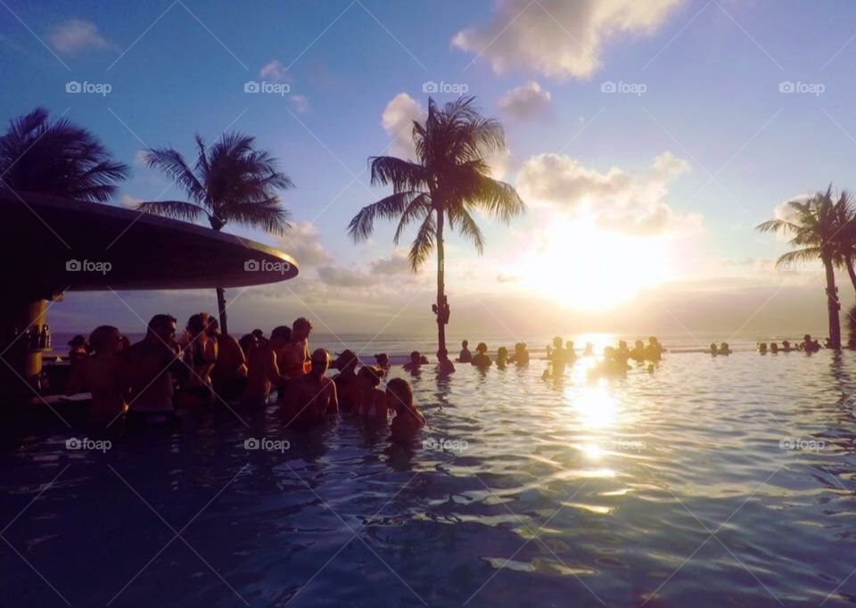 Rio de Janeiro at sunset at the pool with a crowd chilling relaxing