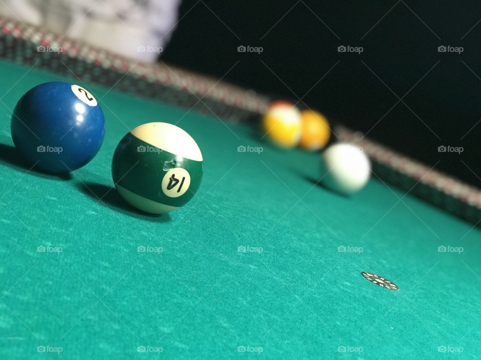 A picture taken of a natural game of pool being played by my friends and I. 'Twas a fun night!! Awesome pic!!