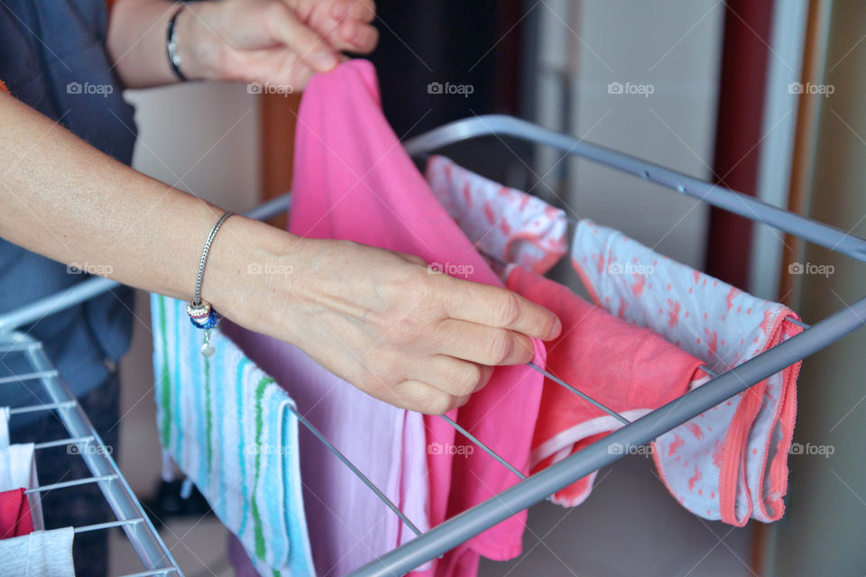 Close-up of a woman's hand drying laundry