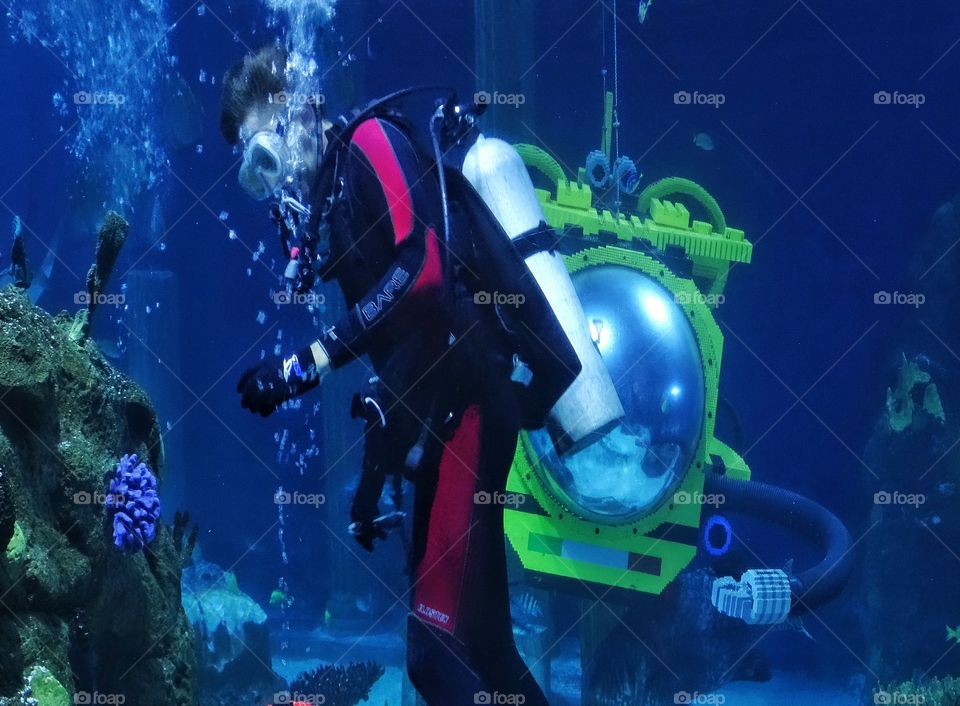 Underwater Exploration. Scuba Diver In Coral Reef With Yellow Submarine