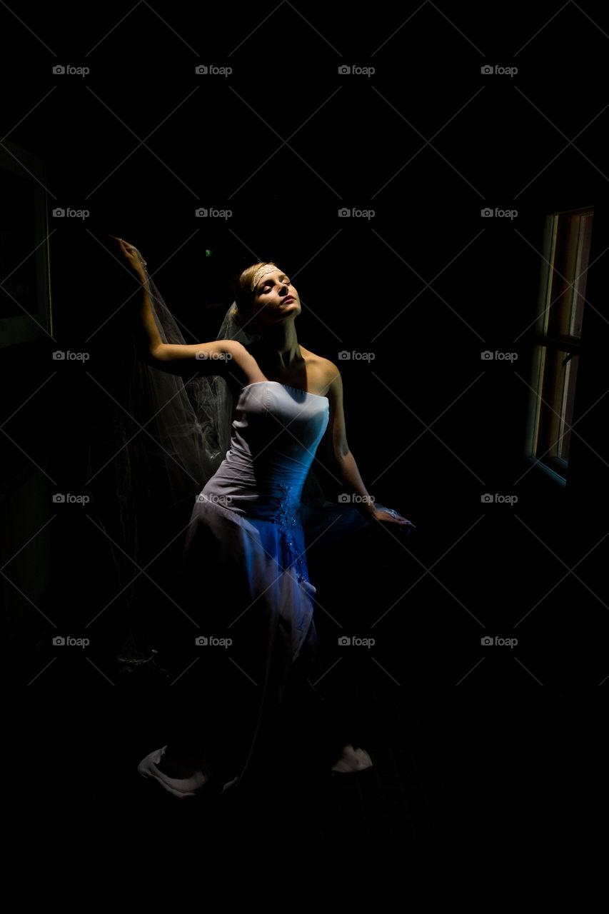 Woman wearing white dress daydreaming