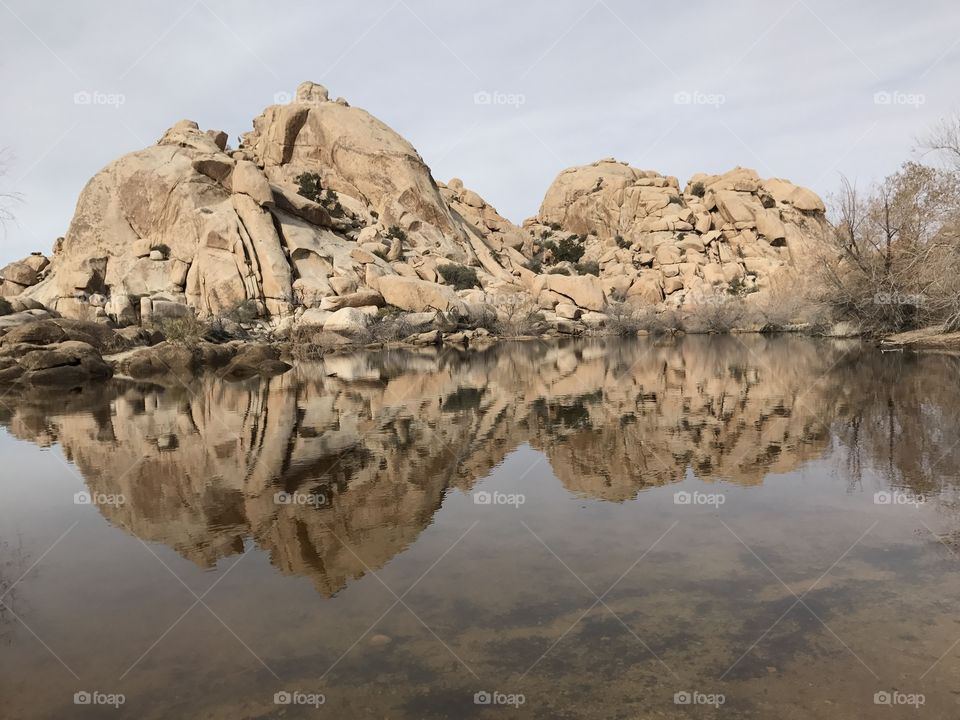 Rock formation reflected on lake