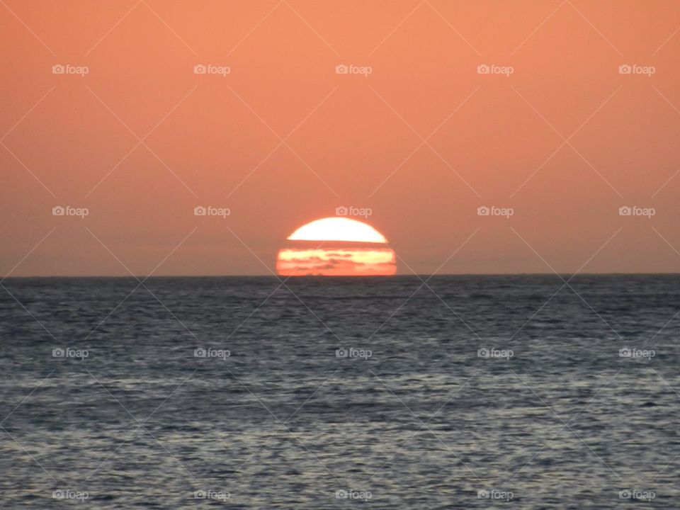 View of sun setting at the horizon