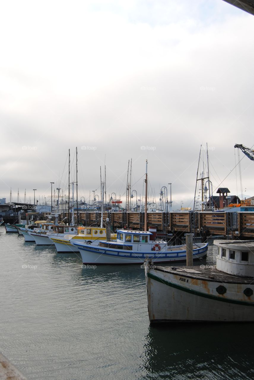 Unmanned boats awaiting their captains in the fog