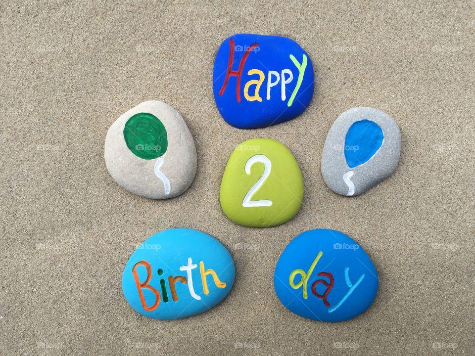 Happy 2 Birthday on colored stones