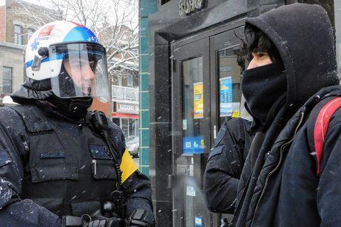 Police versus masked protester