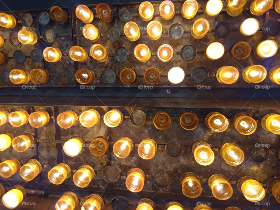 Light candles in church