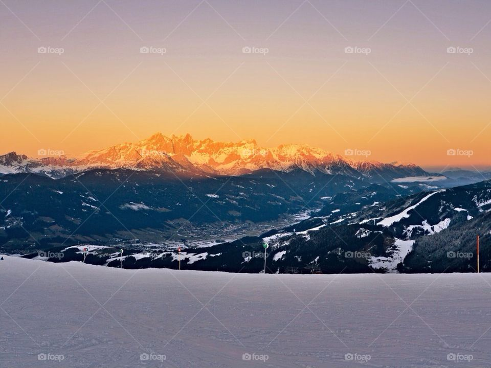 View of snowy mountains in sunset