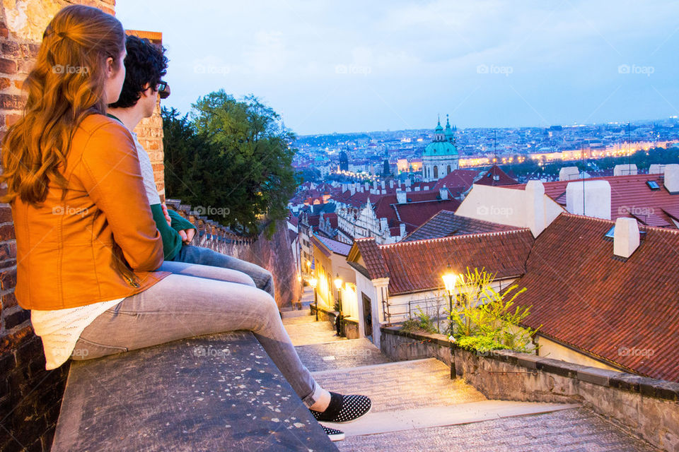 Two people sitting on wall at czech