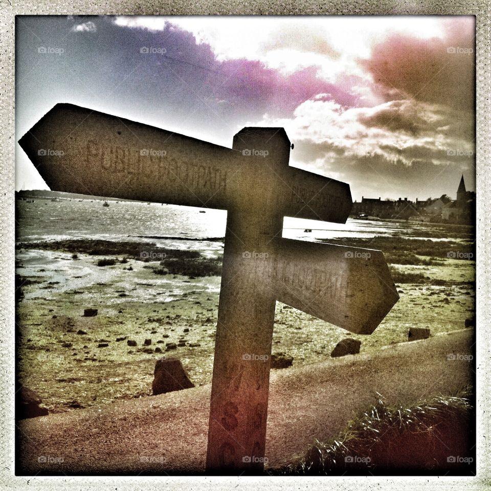 Harbour Walk . Public footpath signposting the way in Bosham Harbour, UK