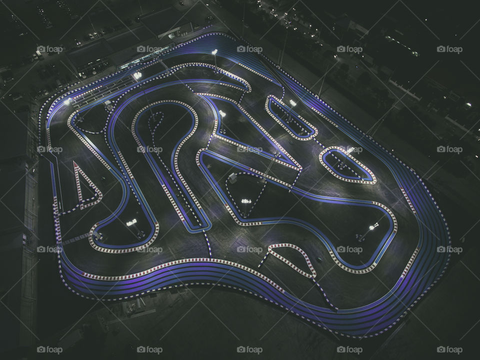 Drone Aerial view of a Go kart racing track at night