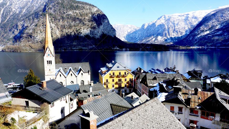 Scenery of Hallstatt lake and snow mountains, Austria