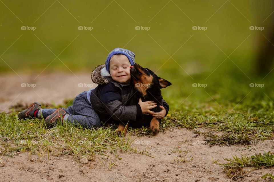 Toddler and puppy love.
