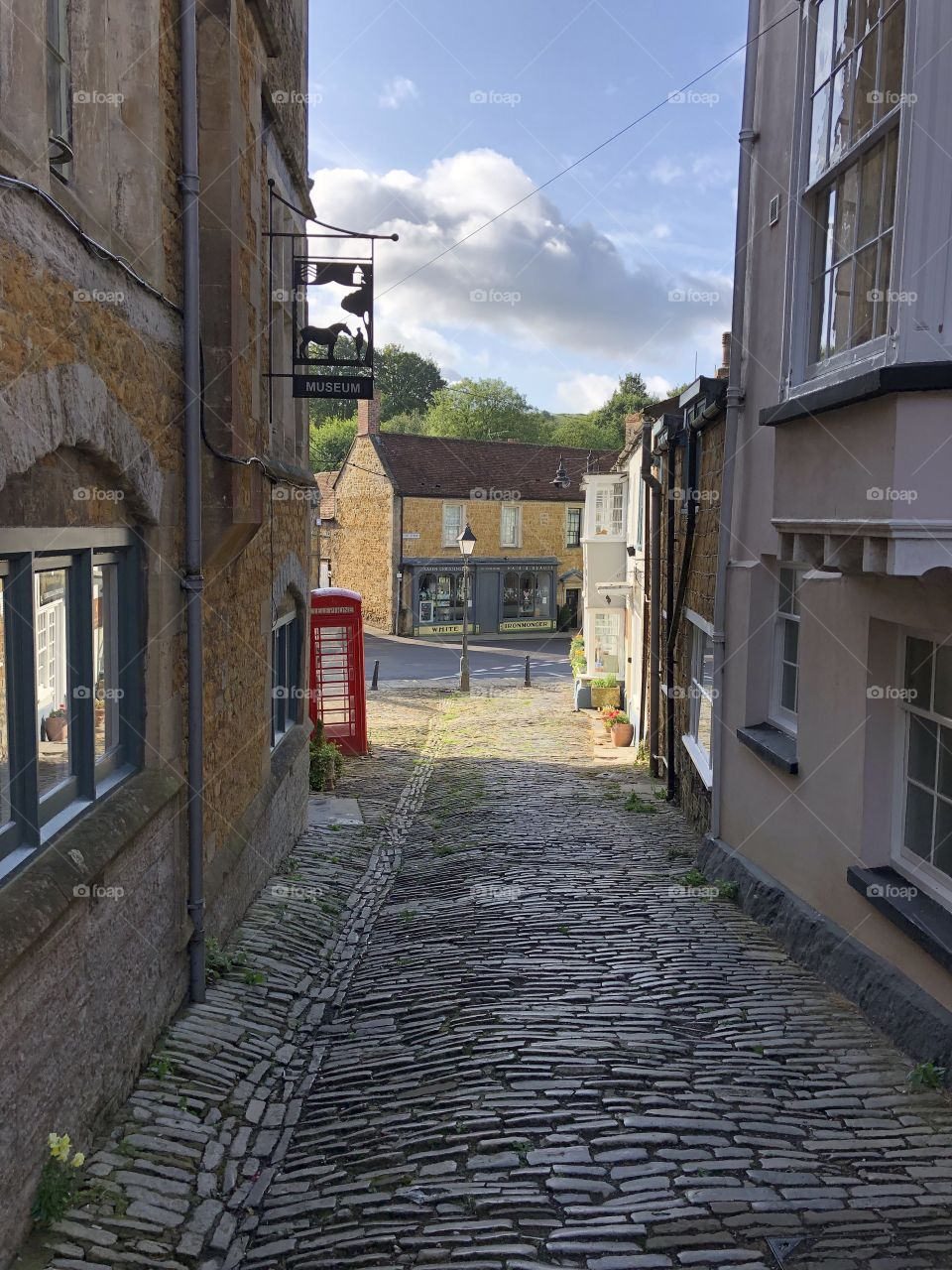 This delightful little pathway to the central point of Castle Cary is a reminder of the picturesque importance of this village. The red telephone box perhaps a reminder of days past and will earn its place in history in the future.
