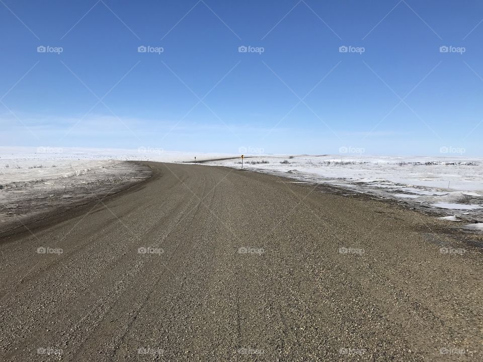 Inuvik-Tuktoyaktuk Highway in the Northwest Territories of Arctic Canada.  This desolate road connects the town of Inuvik to the hamlet of Tuktoyaktuk, which is on the Arctic Ocean.  It is the furthest north you can drive in Canada.
