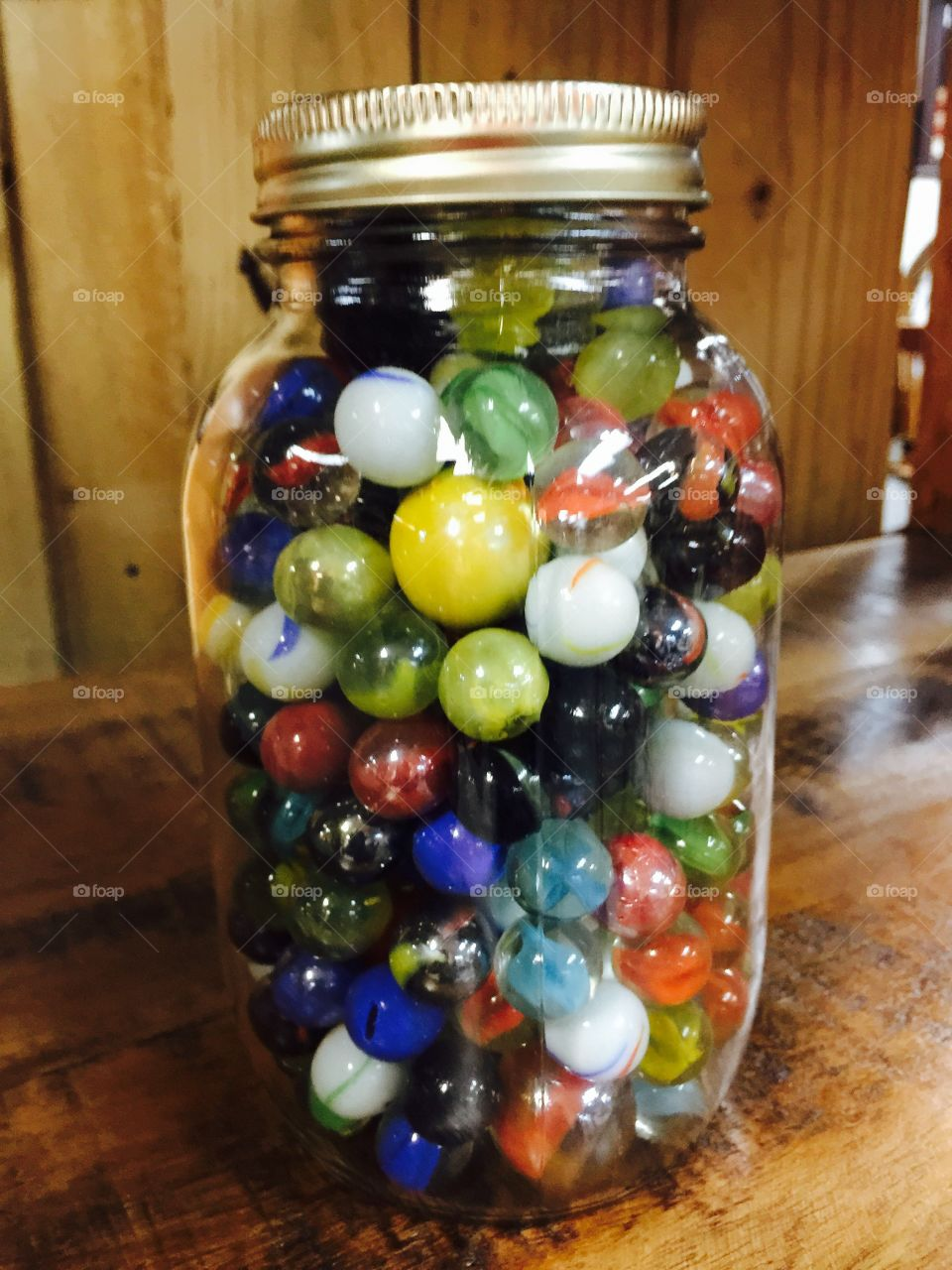 Colorful Marbles in a glass jar