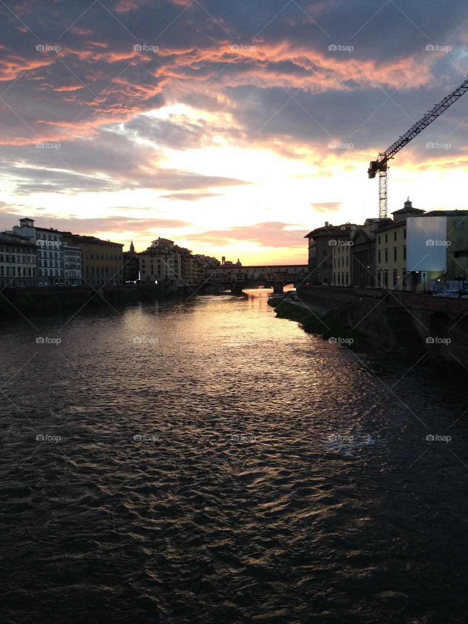 Arno River at sunset in Florence, Italy