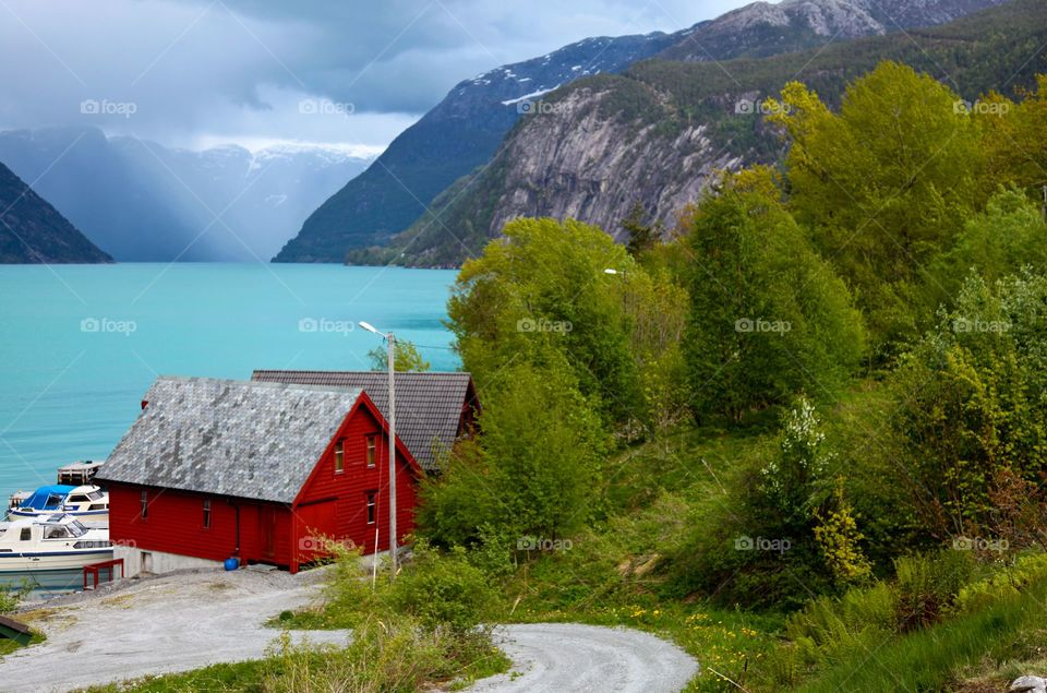 Red house in the fjord.