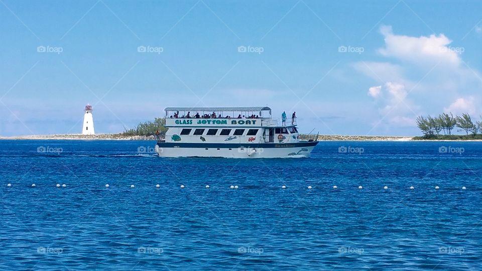 Glass bottom boat tours take you to Paradise island all day long and back Nassau Bahamas