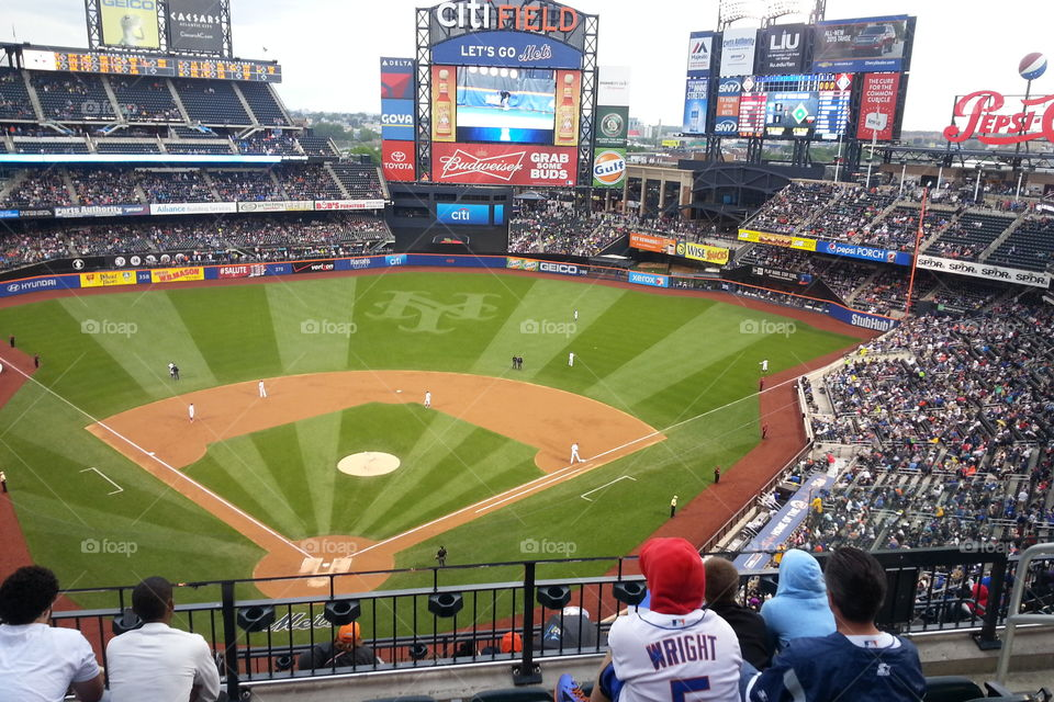 watching the game. citifield
