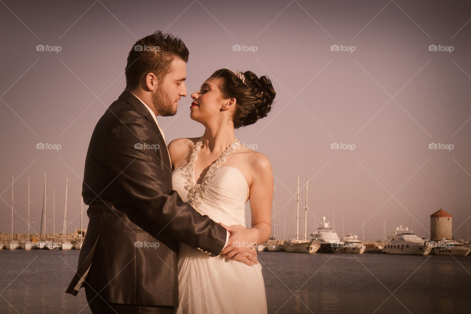 Close-up of romantic couple at sea side