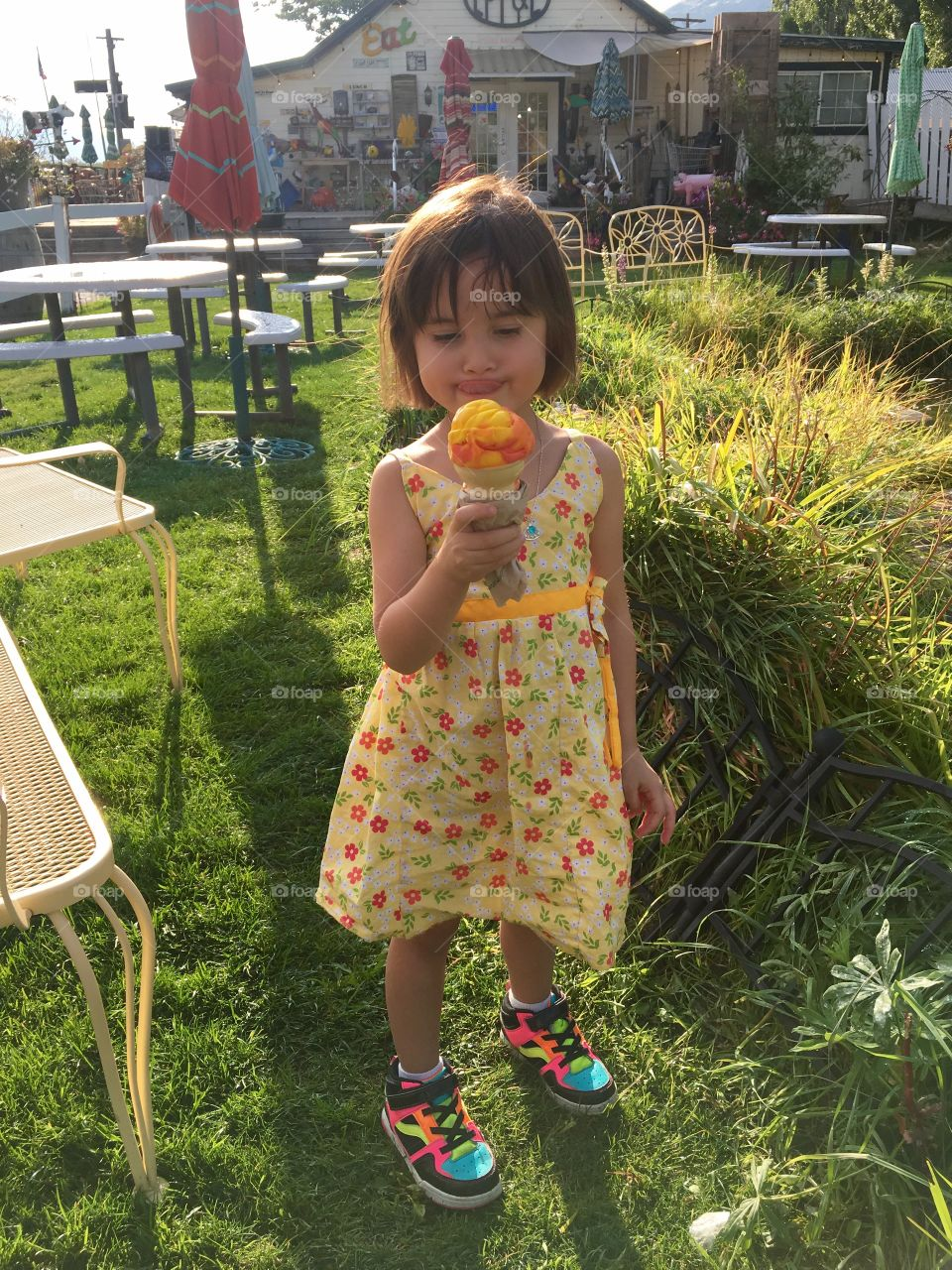 Cute girl holding tasty ice cream