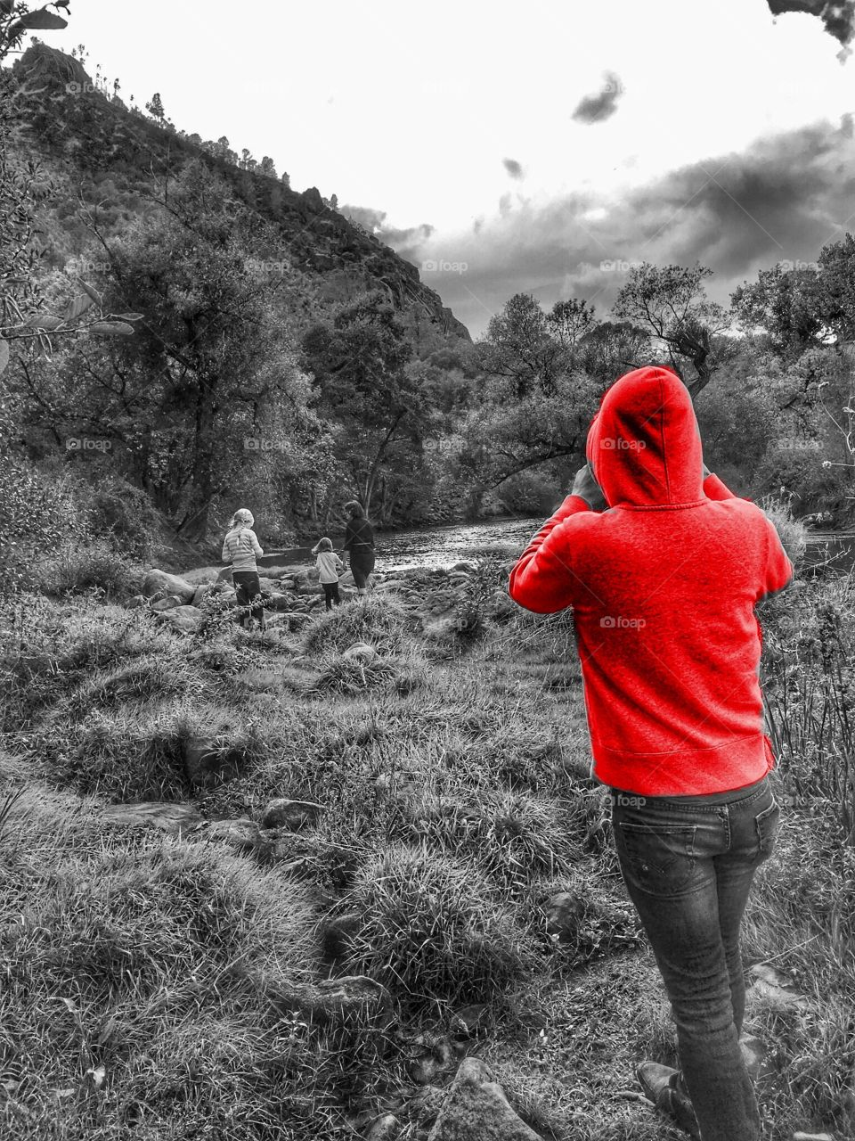 Red hoodie on black and white photo.