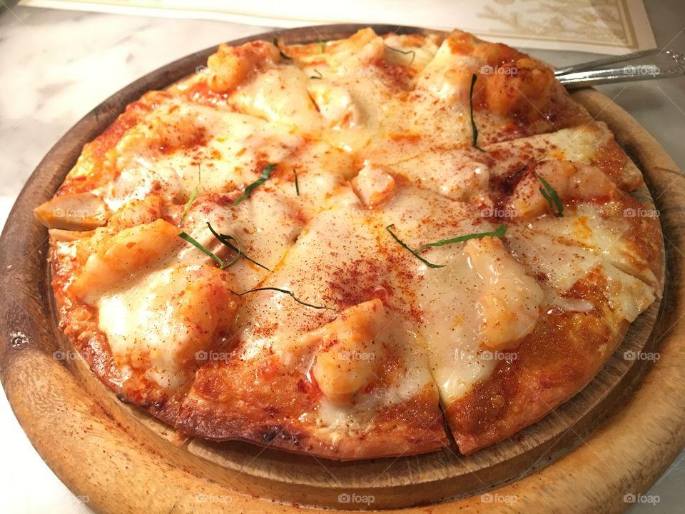 Crispy 'n' tiny pizza in Bangkok