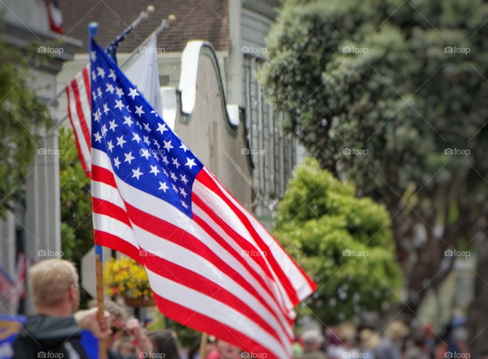 Waving The American Flag. Fourth Of July Mainstreet Parade