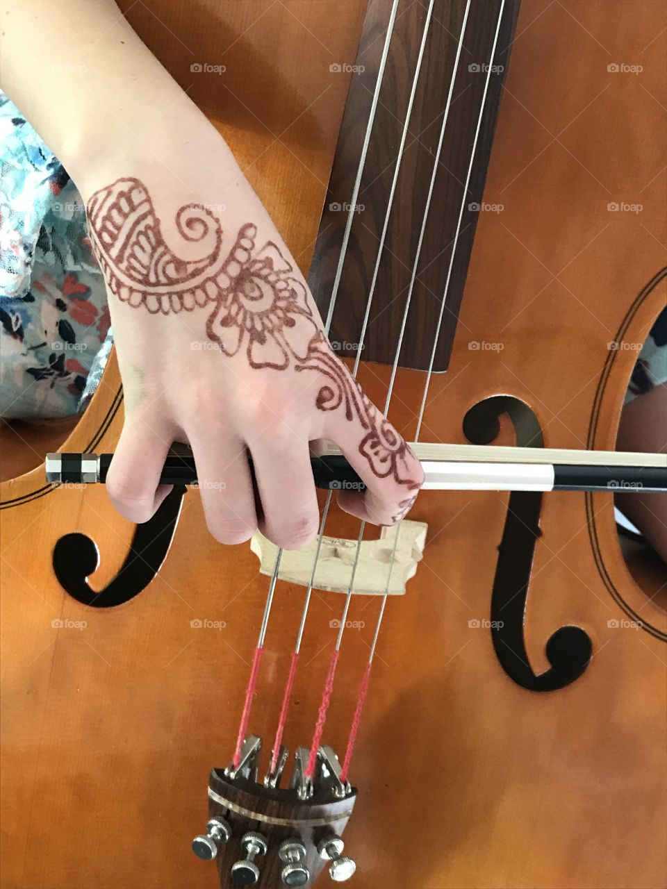 The beauty of music: my amazing pre-teen daughter was practicing her cello for an audition today and the beauty of her hand with the flowery details of henna tattoo set against the slick, smooth lines of the bow and body of the cello struck me as needing to be photographed and shared. Enjoy!