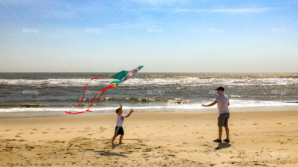Flying kites on a windy and sunny day at the beach. A little slice of heaven!