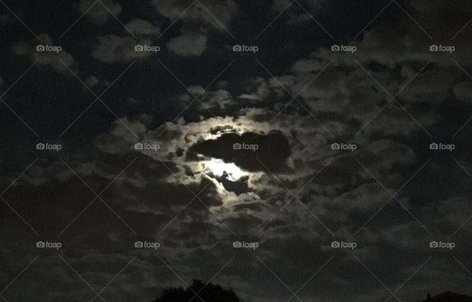 Moon hidden in clouds