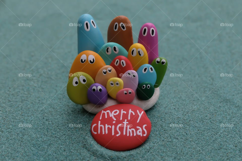 Merry Christmas with multicolored pebble miniatures