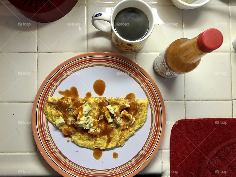 High angle view of omelette with hot coffee