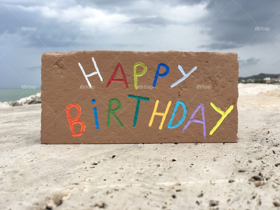 Happy Birthday message carved on a brick