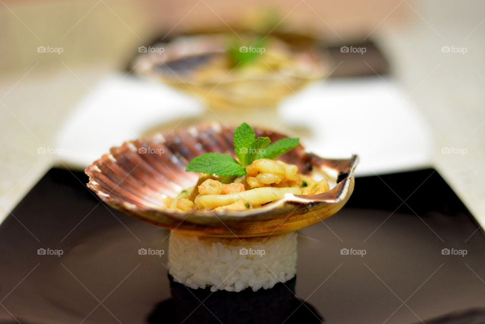 Seafood in scallop shell with rice