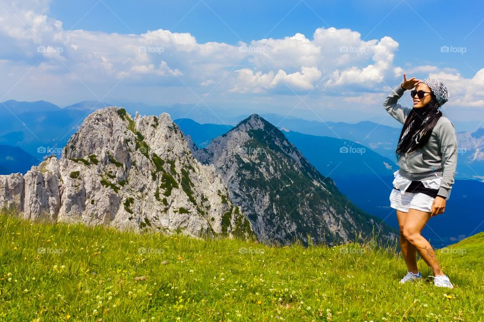 Woman hiker standing at hill