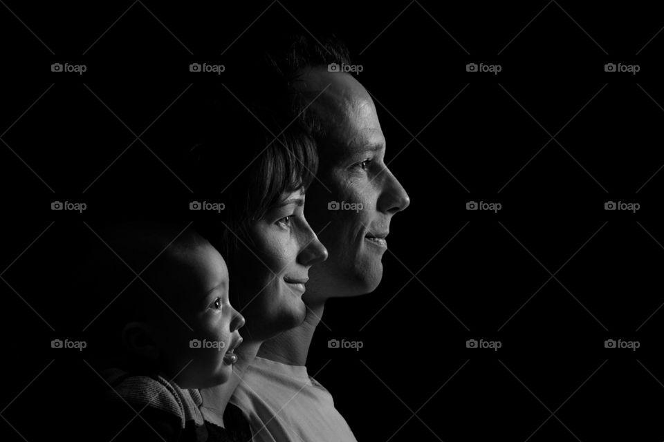 Happy family in black background