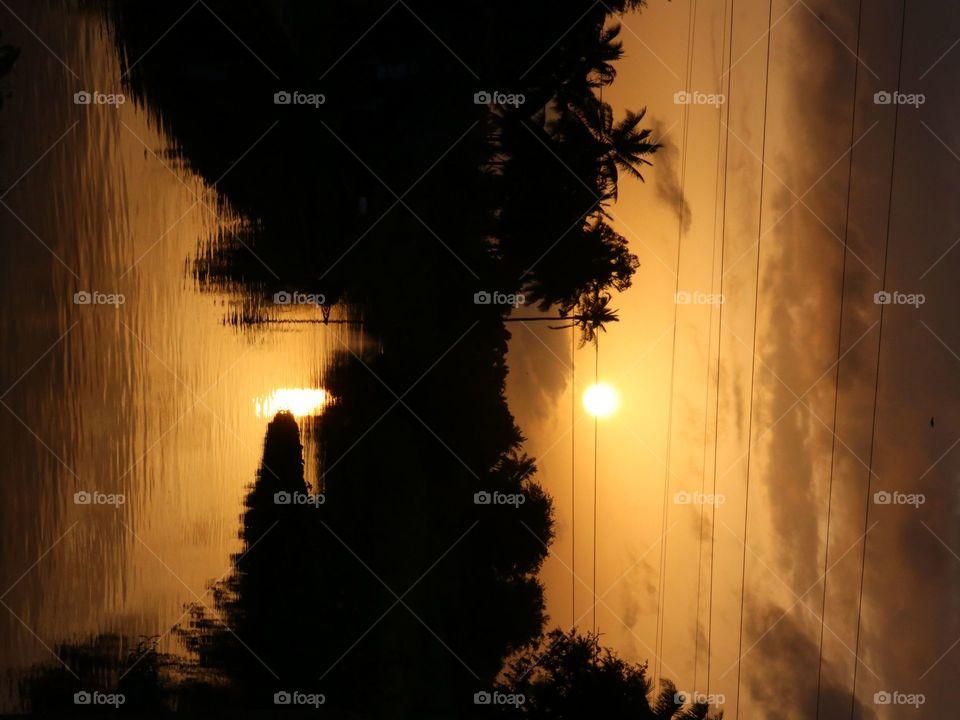 sunrise reflection water